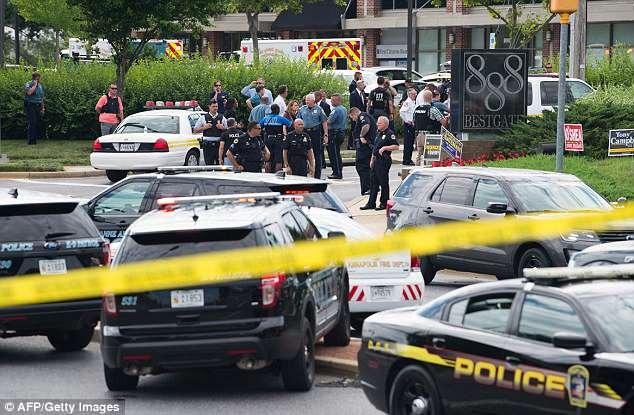 Police respond to a shooting in Annapolis, Maryland, June 28, at the building that houses the Capital Gazette, a daily newspaper published in Annapolis