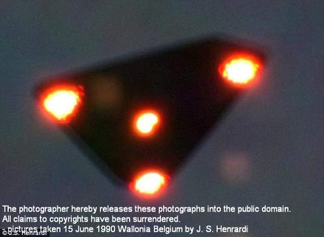 A 1990 picture of a 'UFO' taken in Wallonia, Belgium. A physics professor from University at Albany, State University of New York and former NASA researcher believes there is 'plenty of evidence to support UFOs'