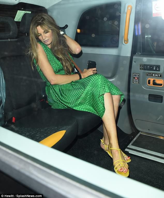 Heading home:The star looked tired as she was seen bundling into the back of a cab following her appearance at the swanky venue