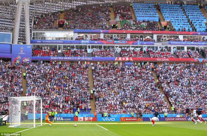 The entire Kazan Arena watches on as Griezmann calmly fires the penalty past a helpless Franco Armani in goal