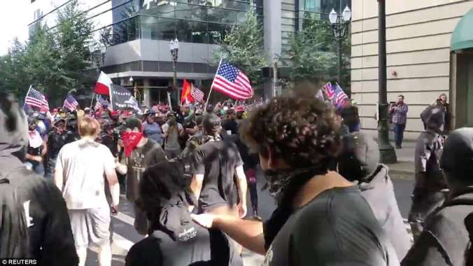 Patriot Prayer (background) had a permit to march on Saturday in Portland when it encountered Antifa (foreground)