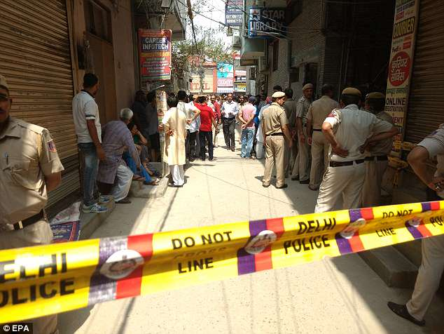 The victims belonged to a family and most had lived in one home in Burari village in the northern part of New Delhi, said police officer Vineet Kumar. Pictured: Police at the scene