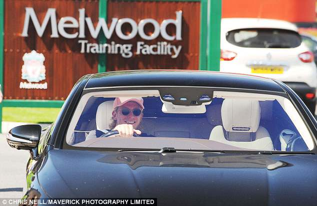 Loris Karius seemed to be in high spirits as he smiled broadly upon arrival at Melwood