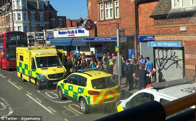A crowd has gathered outside West Hampstead Tube station along with a number of emergency services vehicles