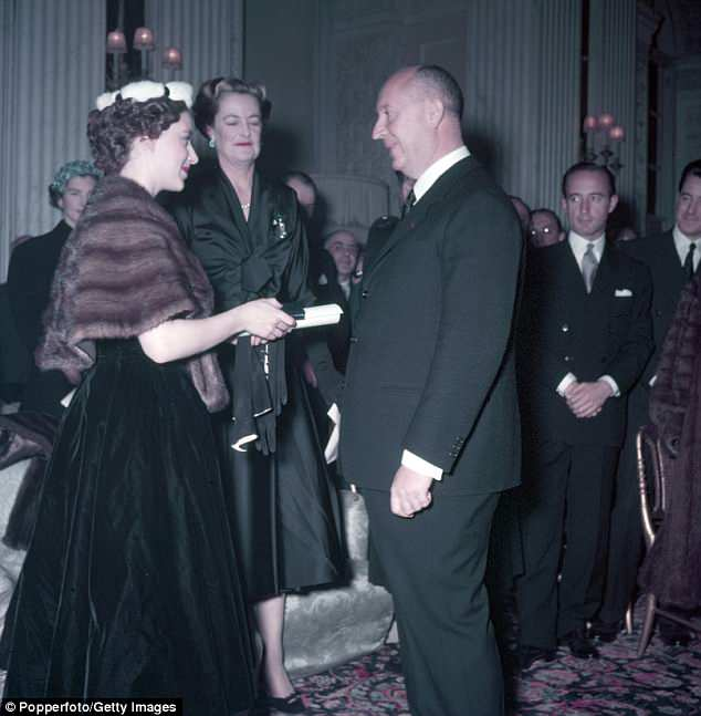 Princess Margaret is pictured withChristian Dior following one of his spectacular shows at Blenheim Palace in 1954