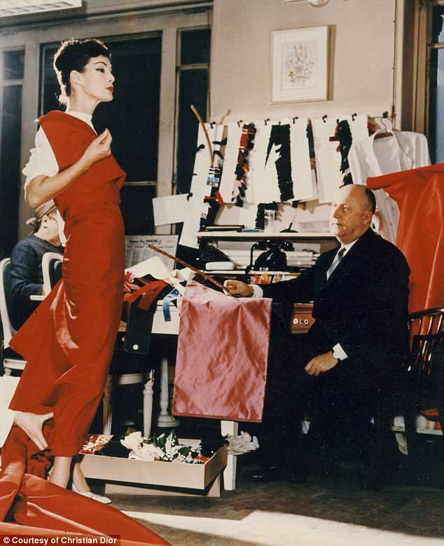 The retrospective will look particularly at the designer's fascination with British culture. Pictured isChristian Dior with model Lucky, circa 1955