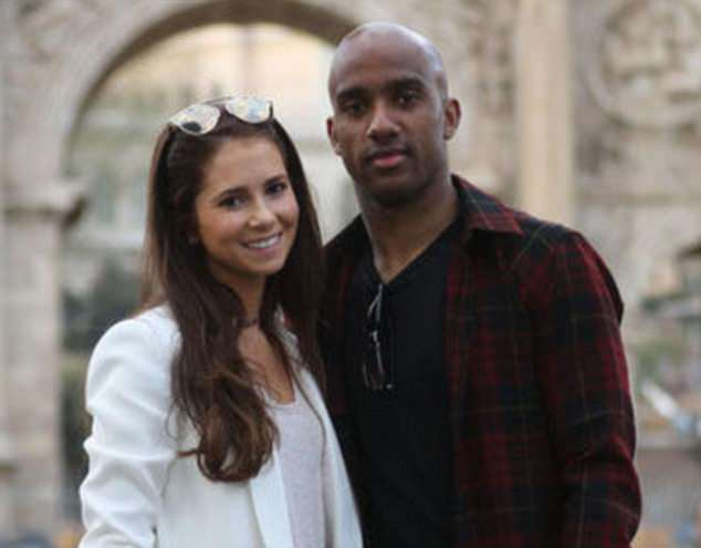 Delph, pictured with his wife, said 'family comes first' as he flew home from Russia
