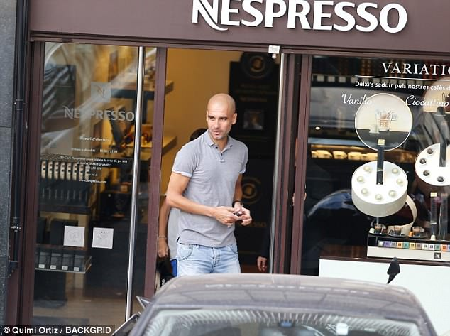 Pep Guardiola leaves a Nespresso shop during a Barcelona shopping trip on Wednesday