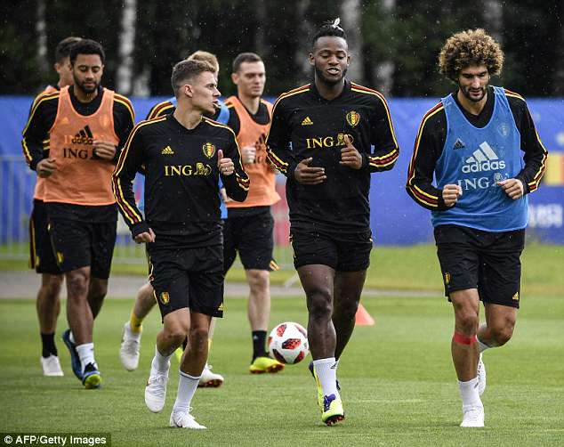 Thorgan Hazard talks withd Michy Batshuayi and Fellaini as they jog off their training session