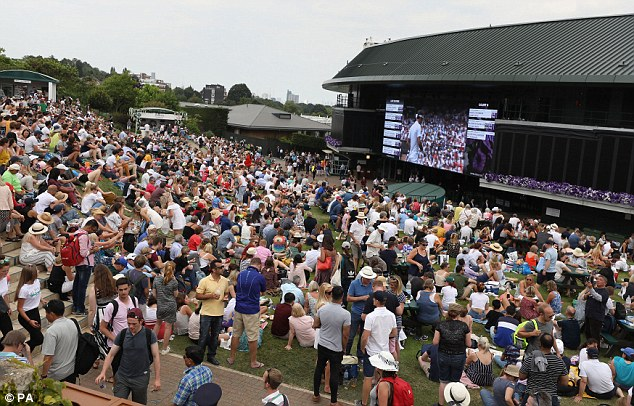 Spectators watch tennis on the big screen on Henman Hill/Murray Mound at Wimbledon in London - but the venue won't be showing the football
