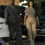 Kim and Kanye West don matching cargo pants in Malibu