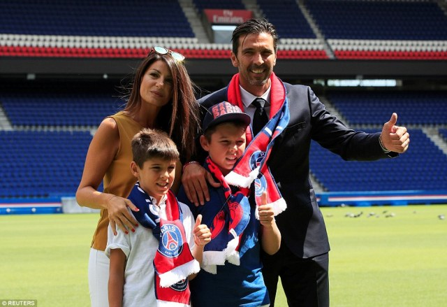 Buffon and his two children David (left) and Louis give the cameras the thumbs-up while his partnerIlaria D'Amico smiles