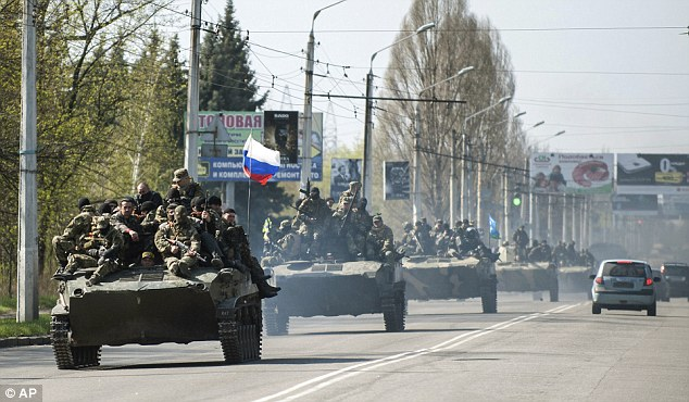 Relations between Ukraine and World Cup hosts Russia remain fraught after the latter's 2014 annexation of the Crimean peninsula and its backing for a pro-Russian uprising in the east of the country. Pictured: Tanks flying the Russian flag in Ukraine in 2014