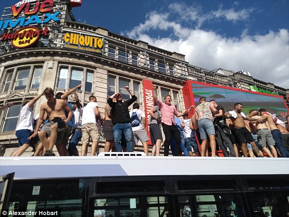Dozens of fans jumped on top of this bus in Manchester as post-match parties got a bit out of hand