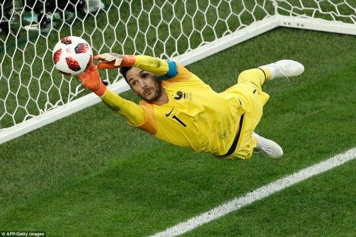 Hugo Lloris was at full stretch to parry Toby Alderweireld's snap shot around the post following a Belgium corner