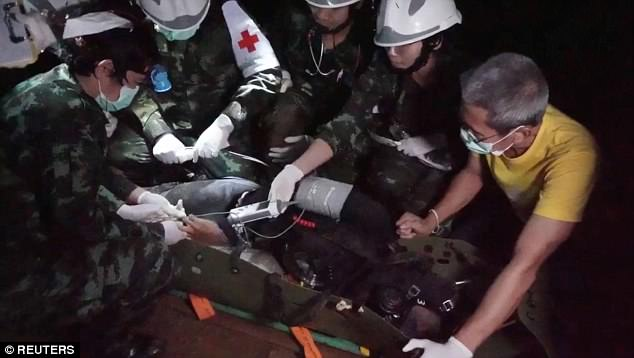 A few seconds earlier he is seen seemingly grasping for one of the rescue medics while still wearing an oxygen mask