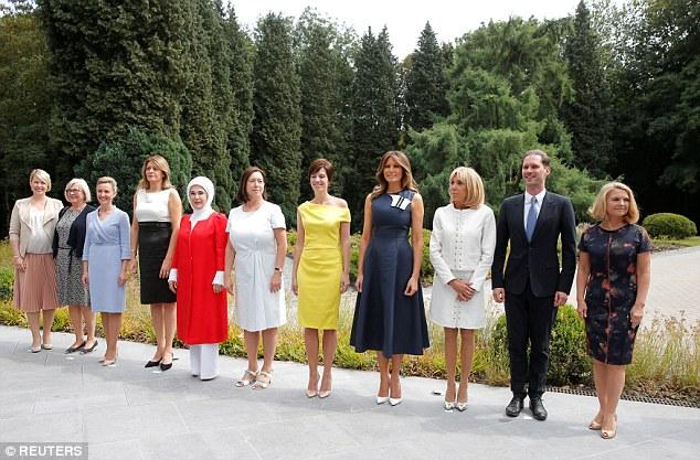 U.S. first lady Melania Trump and France's first lady Brigitte Macron, Sweden Prime Minister's spouse Ulla Lofven, Belgian Prime Minister's partner Amelie Derbaudrenghien, Slovenian Prime Minister Miro Cerar's partner, Mojca Stropnik, Bulgarian President Rumen Radev's partner Desislava Radeva, Turkey's first lady Emine Erdogan, Jens Stoltenberg's spouse Ingrid Schulerud, European Council President Donald Tusk's wife Malgorzata Sochacka, and Luxemburg's Prime Minister Xavier Bettel's husband, Gauthier Destenay, attend a concert at the Queen Elisabeth Music Chapel in Waterloo, Belgium