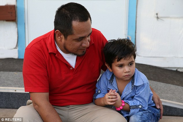 Walter Armando Jimenez Melendez, an asylum seeker from El Salvador, arrived Tuesday with his four year-old son Jeremy at a shelter after being reunited after 3 months apart