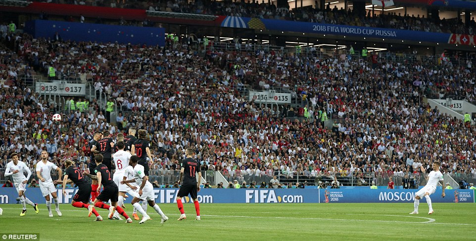 Trippier swings his free-kick over the jumping Croatian wall and beyond the despairing dive ofDanijel Subasic in Moscow