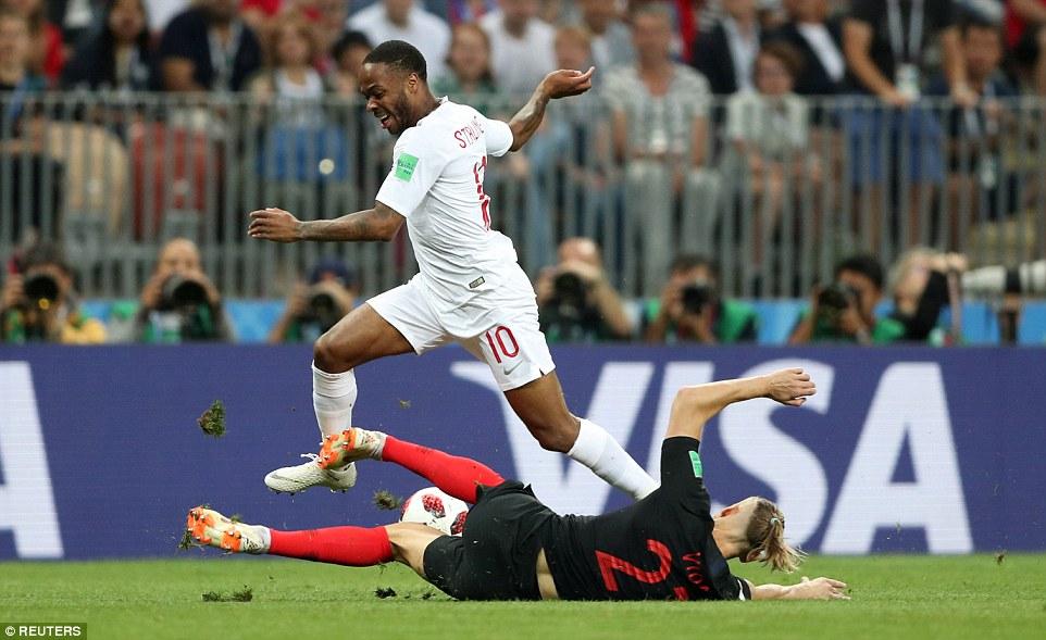 England forward Raheem Sterling looks to break forward early in the game but is denied byCroatia's Domagoj Vida