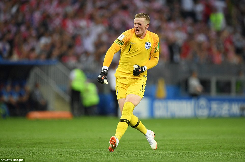 Goalkeeper Jordan Pickford punches the air in celebration after England's early strike at the Luzhniki Stadium against Croatia