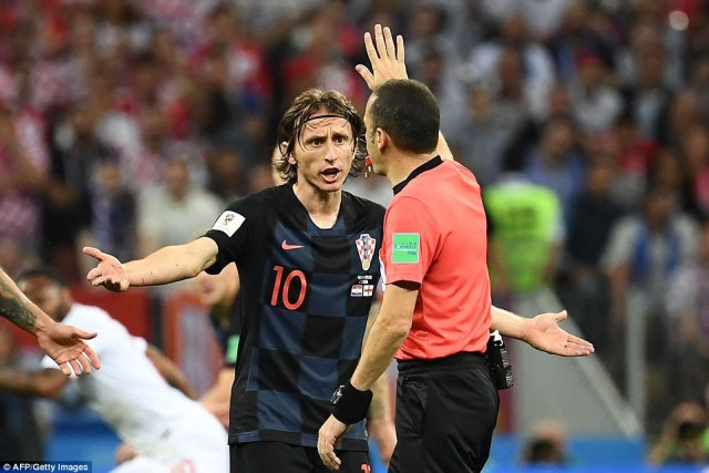 Luka Modric remonstrates with refereeCuneyt Cakir as another decision goes against Croatia in the first-half in Moscow