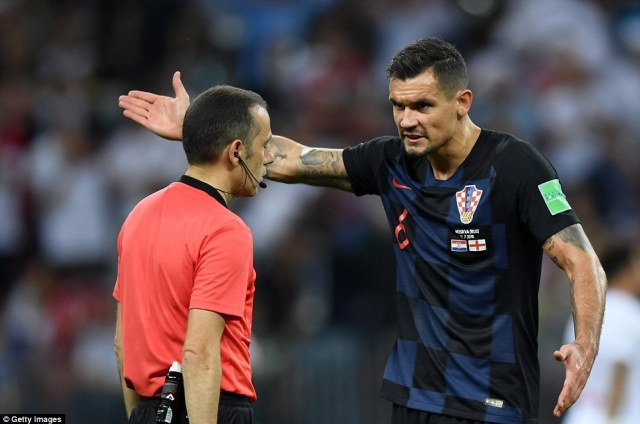 Dejan Lovren makes his feelings known to the referee as he felt Croatia were denied a penalty on the stroke of half-time