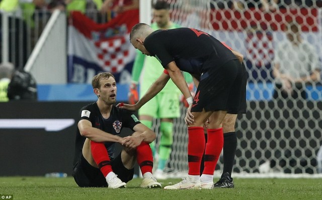 Ivan Perisic checks on his Croatian team-mate Ivan Strinic, who has to be taken off due to an injury in extra-time
