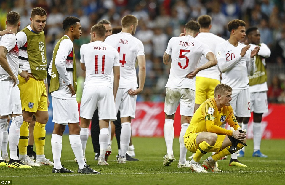 The England players gathered in the centre circle after the game as they come to terms with the defeat by Croatia