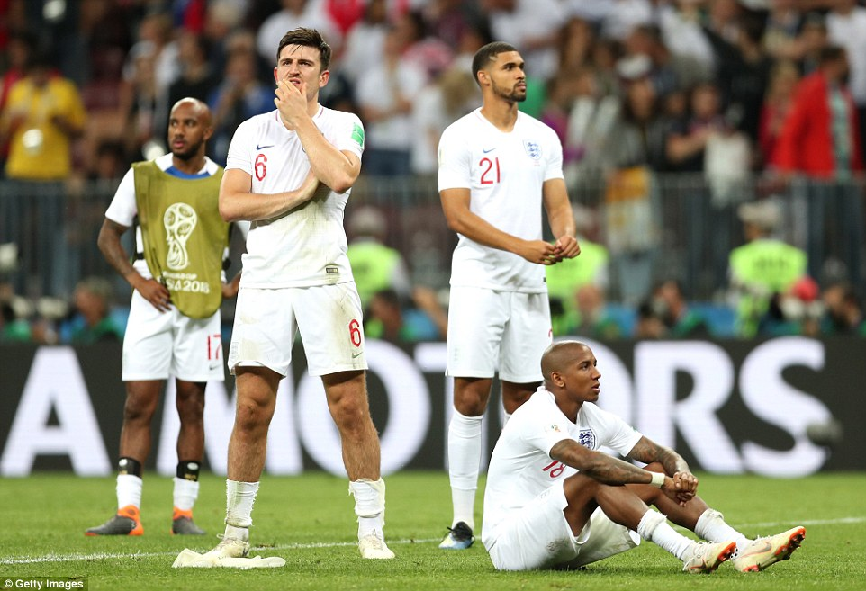England's players look dejected after the final whistle blows to confirm their World Cup exit at the semi-final stage