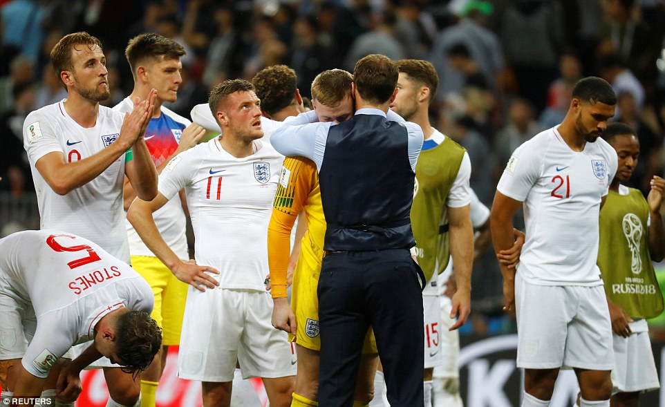 Gareth Southgate saves a hug for England's heroic No 1 Jordan Pickford after the end of the game on Wednesday night