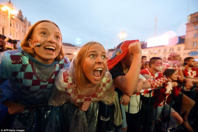Croatia fans smile and cheer as they watch their side overcome a profligate England in Moscow. It the tiny Balkan nation's first ever World Cup final