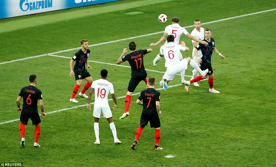 Stones rises highest to direct a free header towards goal but his effort was agonisingly cleared off the line by Croatia