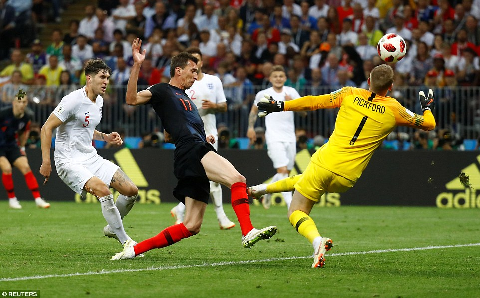 Pickford rushes off his line to deny Mandzukic as Croatia search for a winner in the first-half of extra-time on Wednesday