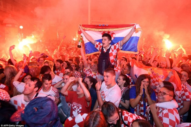 Croatia's supporters celebrate the second goal as they watch on a giant screen the Russia 2018 World Cup semi-final football match between Croatia and England