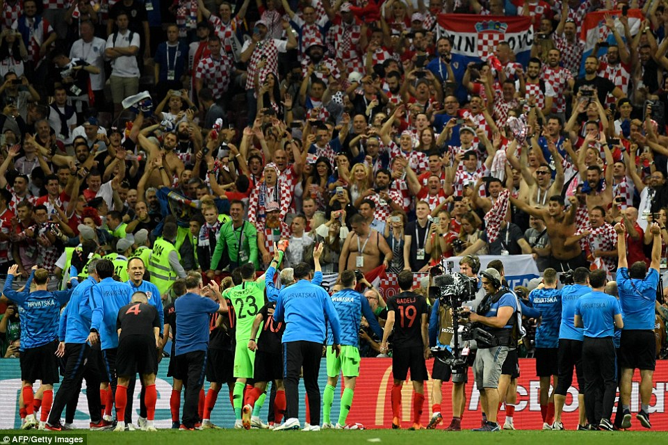 Croatia celebrate with their hordes of fans inside the Luzhniki Stadium after their place in the final was confirmed with victory