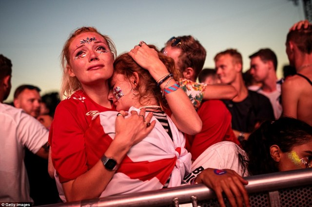 Girls who had earlier screamed their team on from Hyde Park in London consoled one another after the 2-1 defeat in Moscow
