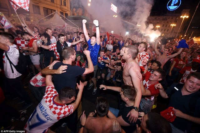 'It's tough, we're gutted,' England's Harry Kane said. 'We worked so hard, the fans were amazing, it was a tough game, a 50-50 game, when we look back we will think there's stuff we could have done better'. Pictured: Croatia fans celebrating their win