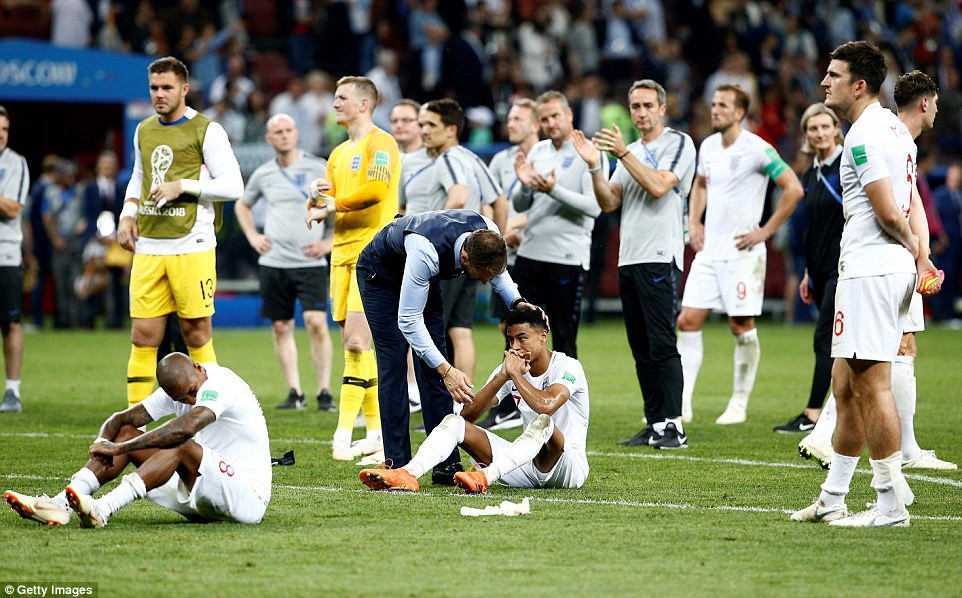 Southgate was seen going around all of his players to check on them, including Jesse Lingard, pictured, who sank to the floor after the match