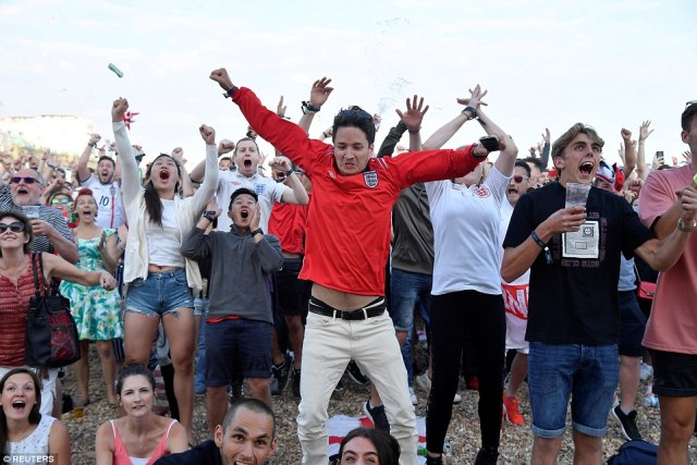 Fans on the beach launched themselves - and their drinks - into the air as Kieran Tripper buried the first goal in the semi final