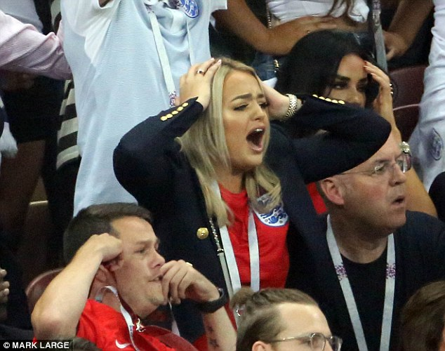 Megan Davison was photographed in various stages of despair as she watched her goalkeeper boyfriend slump to defeat against Croatia in Moscow's Luzhniki Stadium