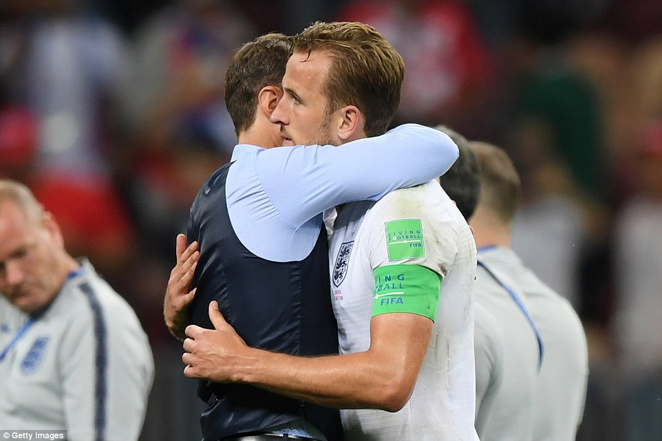 He also shared a hug with England's captain and star striker Harry Kane, pictured, after the gruelling 120-minute match