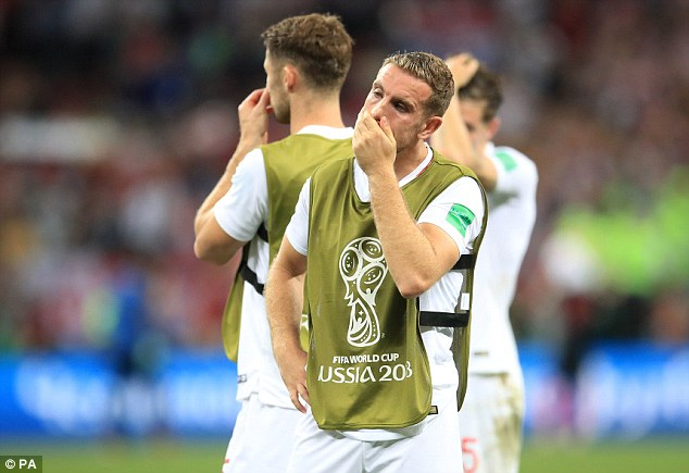 Henderson cups his mouth with his hand as he tries to come to terms with the 2-1 defeat