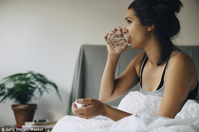 There are other ways to tell if you're dehydrated, includingsmall appetite, intense thirst, exhaustion, headaches, and poor memory (stock image)