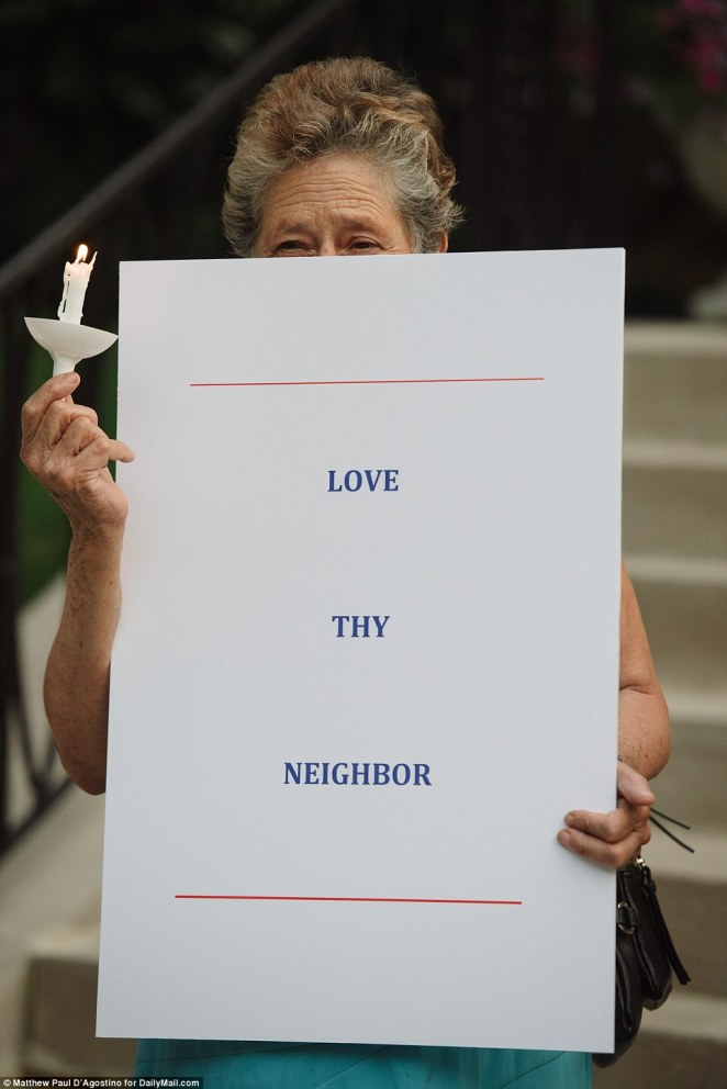 But Ivanka was at an evening appointment and didn't return until the protest was over (pictured a demonstrator holds a sign which reads 'Love thy neighbor')