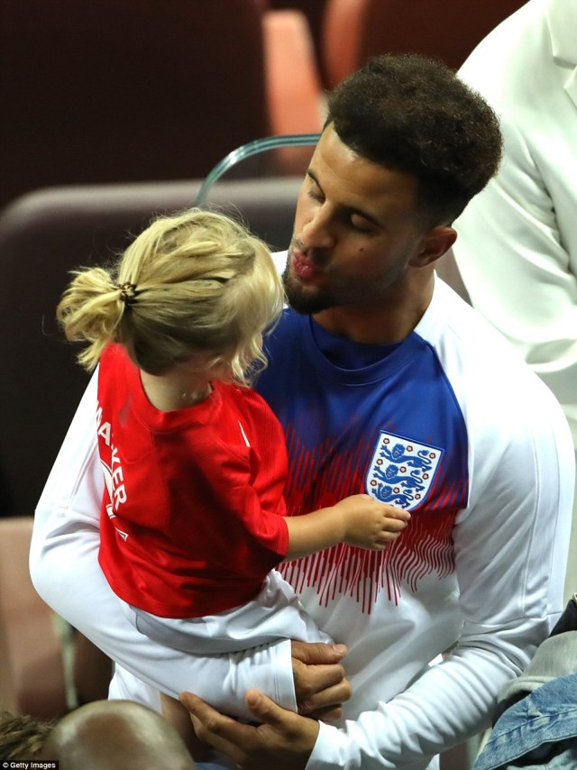 Kyle Walker kisses his daughter as England after the World Cup exit in the Luzhniki Stadium, Moscow, last night
