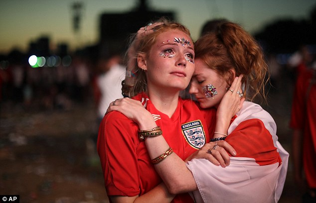 People consoled one another in the wake of the Three Lions' devastating defeat