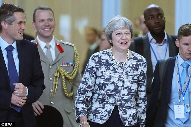 Theresa May (pictured at the NATO summit in Brussels today) has made clear she welcomes the 'engagement' between the US president and the Russian president on Monday