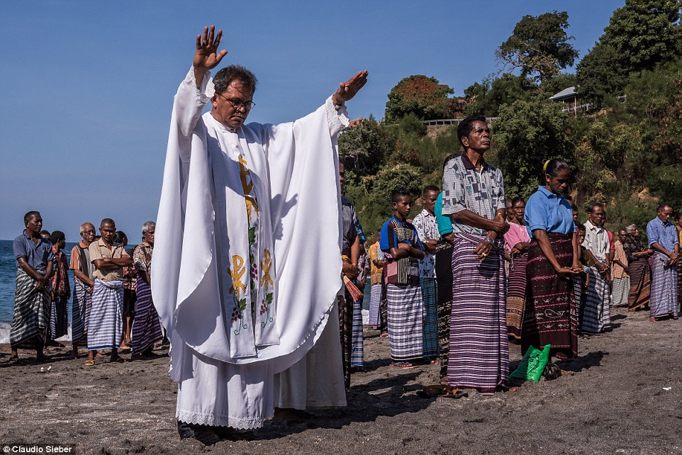 A Catholic priest blesses the fishermen on the last day of the Leva Season opening ceremony just before they go whale hunting