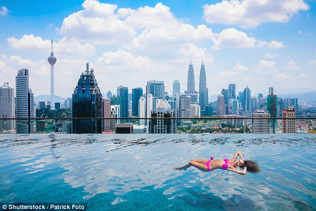 For less than $100 keen travellers can jump on a plane to Kuala Lumpur (pictured) from Melbourne
